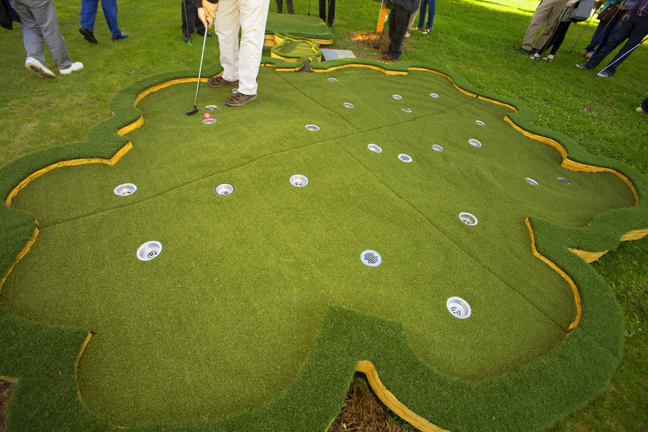 18 Holes in One<br /> (with Stephen Mohring)<br /> Walker on the Green- Minneapolis Sculpture Garden, David Lefkowitz, 2013